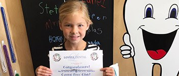 Child posing with certificate