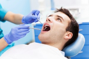 ThinkstockPhotos-man oral exam